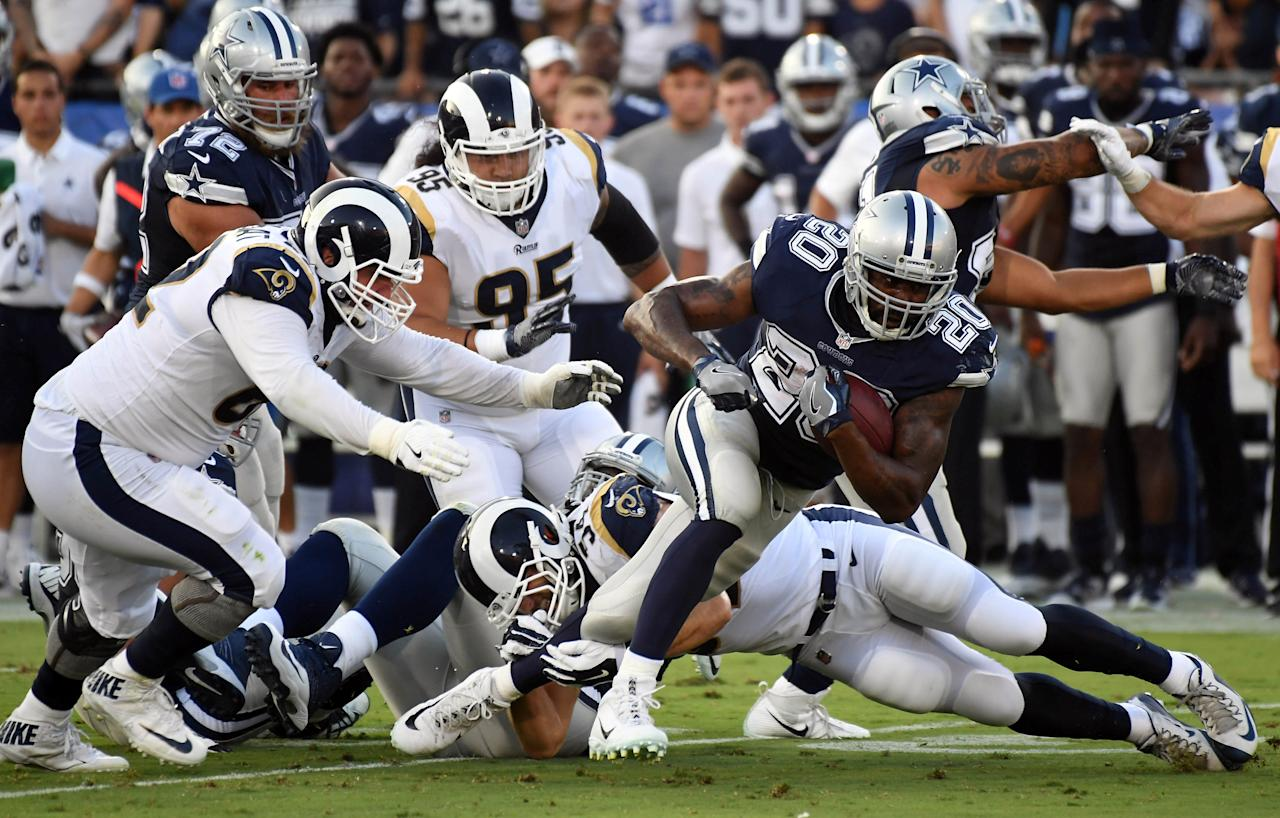 Aug 12, 2017; Los Angeles, CA, USA; Dallas Cowboys running back Darren McFadden (20) runs the ball against the Los Angeles Rams in the first half during a preseason NFL game at Los Angeles Memorial Coliseum. Mandatory Credit: Richard Mackson-USA TODAY Sports?     TPX IMAGES OF THE DAY
