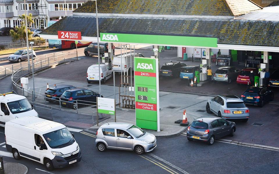 Brighton UK 24th September 2021 - Customers queue for fuel at a supermarket petrol station in Brighton this morning - Simon Dack News/Alamy Live News
