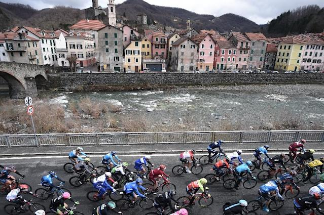 The pack rides in Campo Ligure during the 109th edition of the Milan - San Remo cycling race on March 17, 2018 (AFP Photo/Marco BERTORELLO )