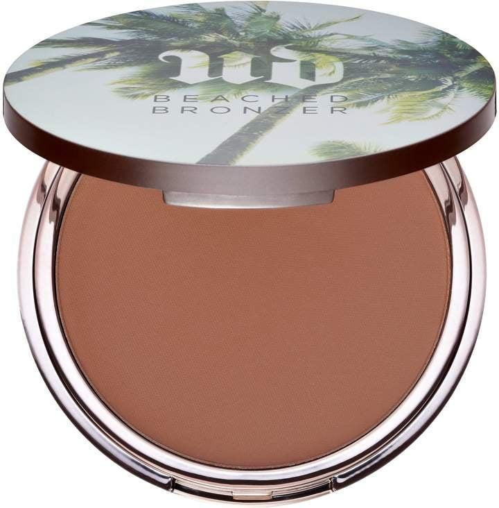 <p>Don't head to the beach without your <span>Urban Decay Beached Bronzer</span> ($32), which will make you look seriously tan and sculpted.</p>