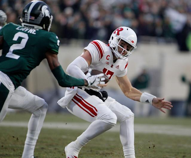 Rutgers quarterback Giovanni Rescigno tries to escape Michigan State's Justin Layne (AP Photo)