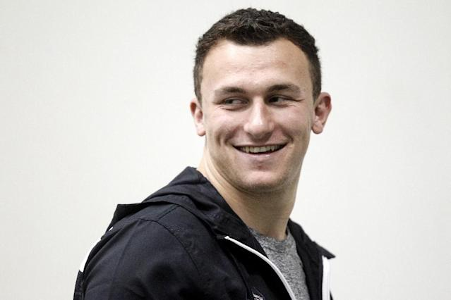 Texas A&M quarterback Johnny Manziel walks the field during Texas A&M's pro day Wednesday, March 5, 2014, in College Station, Texas. Manziel did not compete in the Pro Day. (AP Photo/Patric Schneider)