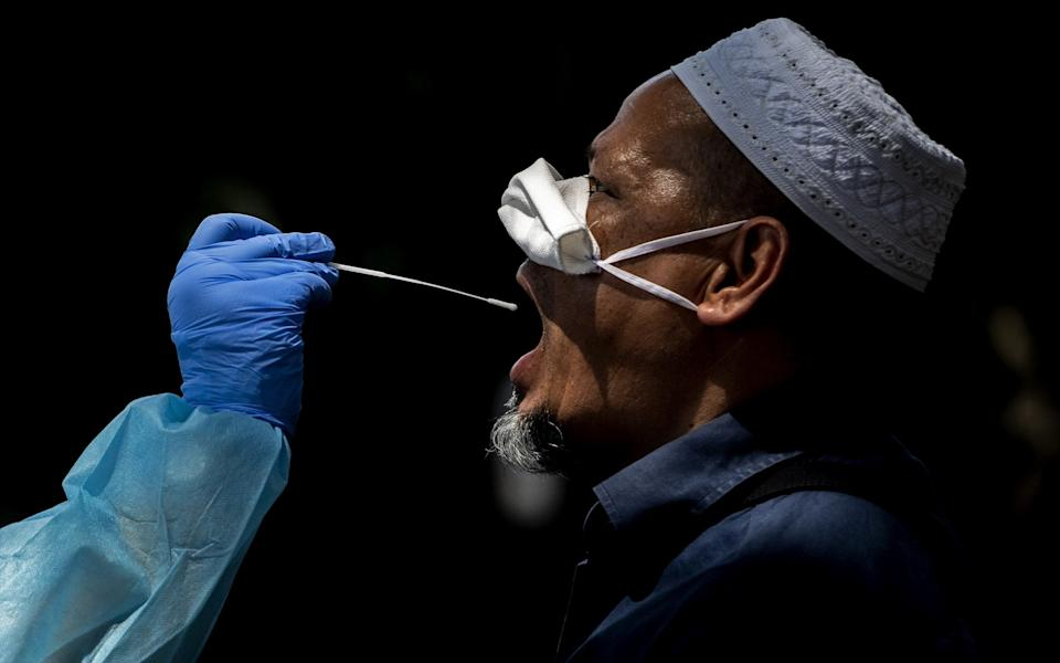 Health workers collect swabs on Bangladesh community in Rome - Getty