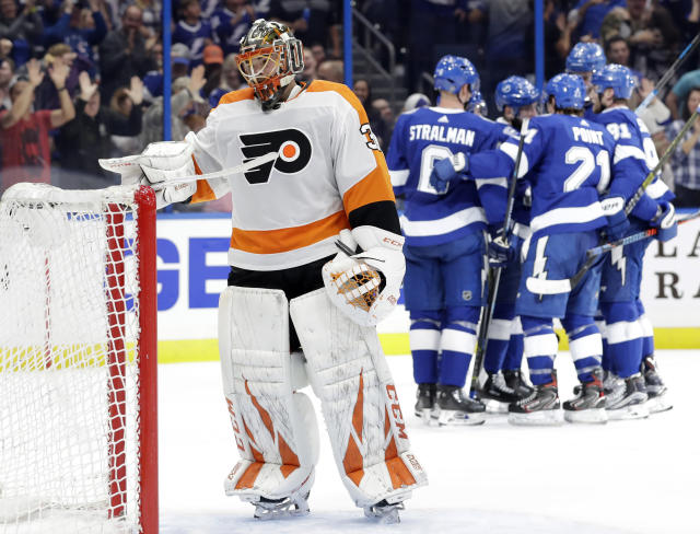 FILE - In this Dec. 27, 2018, file photo, Philadelphia Flyers goaltender Michal Neuvirth (30) reacts as the Tampa Bay Lightning celebrate a goal by Tyler Johnson during the second period of an NHL hockey game, in Tampa, Fla. The Flyers crashed from a 98-point team that made the playoffs to the one of the worst teams in the NHL; they fired the coach, the general manager and play in front of a half-empty Wells Fargo Center where tickets bottomed out at $9 a pop on StubHub on Wednesday, Jan. 9, 2019. (AP Photo/Chris O'Meara, File)