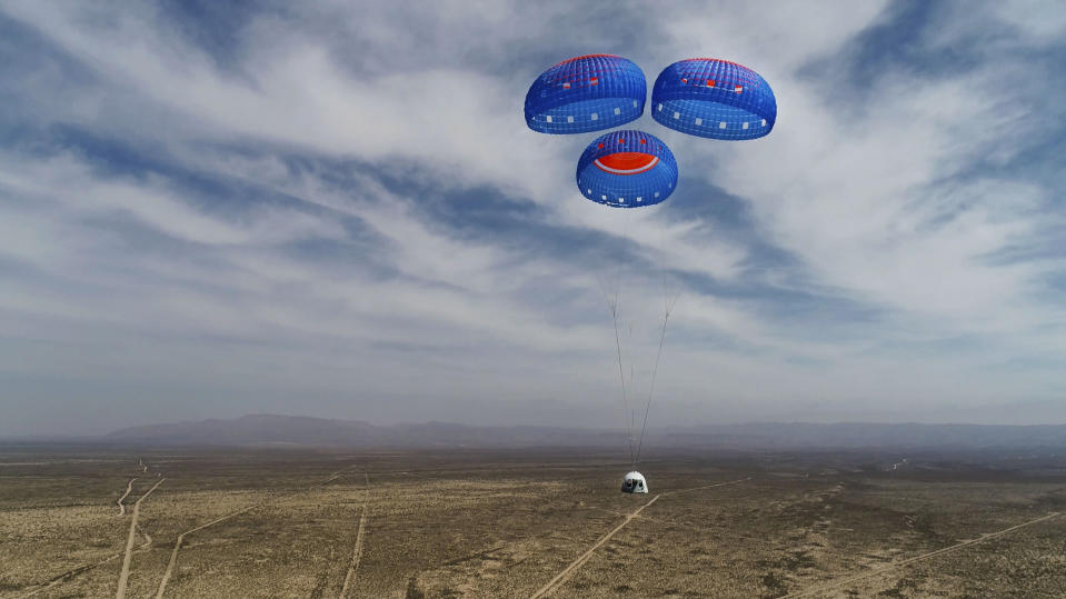 In this April 14, 2021 photo made available by Blue Origin, the New Shepard Crew Capsule descends from space on during a test in West Texas. (Blue Origin via AP)