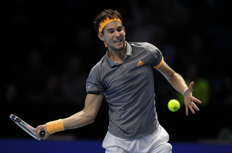 Dominic Thiem of Austria plays a return to Alexander Zverev of Germany during their ATP World Tour Finals semifinal tennis match at the O2 Arena in London, Saturday, Nov. 16, 2019. (AP Photo/Kirsty Wigglesworth)