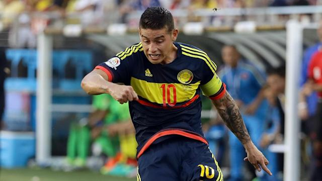 Colombia beat Ecuador 2-0 in Quito to boost their World Cup hopes, thanks to goals from James Rodriguez and Juan Cuadrado.