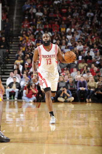 HOUSTON, TX - JANUARY 8: James Harden #13 of the Houston Rockets drives up-court against the Los Angeles Lakers on January 8, 2013 at the Toyota Center in Houston, Texas. (Photo by Bill Baptist/NBAE via Getty Images)