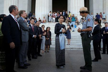 FILE PHOTO: Myanmar's State Counsellor Aung San Suu Kyi is guided by U.S. National Park Service Ranger Heath Mitchell (R) as she visits the Lincoln Memorial in Washington, U.S., September 14, 2016. REUTERS/Jonathan Ernst/File Photo