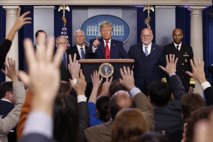 President Donald Trump, center, points as he prepares to answer question after speaking about the coronavirus in the press briefing room at the White House, Feb. 29, 2020, as Health and Human Services Secretary Alex Azar, National Institute for Allergy and Infectious Diseases Director Dr. Anthony Fauci, Vice President Mike Pence, Robert Redfield, director of the Centers for Disease Control and Prevention and U.S. Surgeon General Dr. Jerome Adams listen. (AP Photo/Carolyn Kaster)