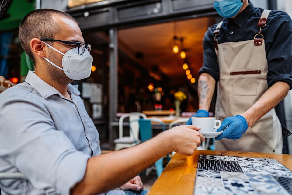 Restaurants have embraced multiple safety measures to stay open. If diners want their favorite spots to remain open amid the pandemic, masking up when interacting with staff is the least they can do. (Photo: urbazon via Getty Images)