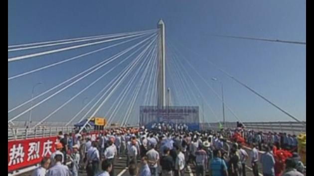 The world's biggest multi-pylon cable-stayed bridge opens in China with carnival like party. .