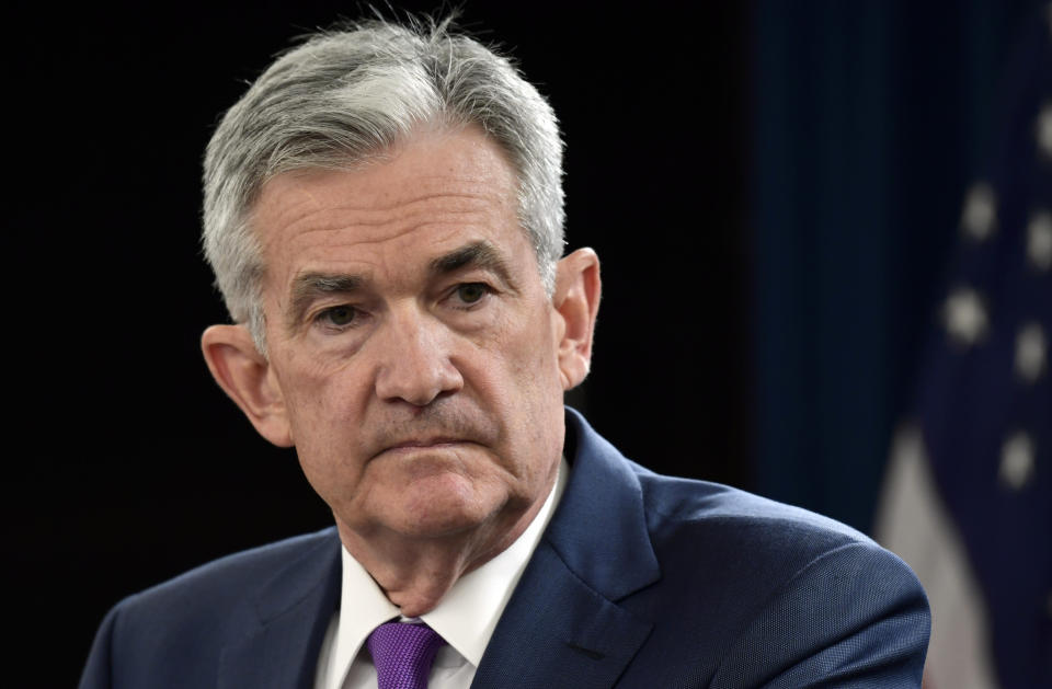 In this Sept. 26, 2018, file photo Federal Reserve Chairman Jerome Powell listens to a question during a news conference in Washington. The Federal Reserve is signaling potentially vulnerable spots in the financial system, citing U.S. businesses' debt at the highest levels in more than two decades and risky debt growing. The Fed's report issued Wednesday, Nov. 28, was its first assessing the stability of the U.S. financial system. (AP Photo/Susan Walsh)