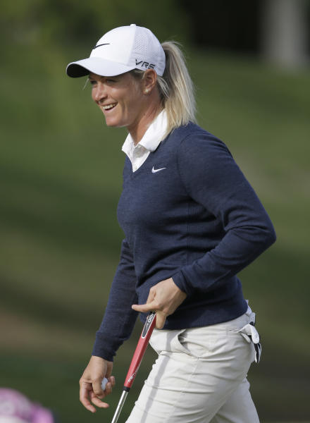 Suzann Pettersen, of Norway, smiles after putting on the eighth hole during the first round of the North Texas LPGA Shootout golf tournament at the Las Colinas Country Club in Irving, Texas, Thursday, May 1, 2014. (AP Photo/LM Otero)