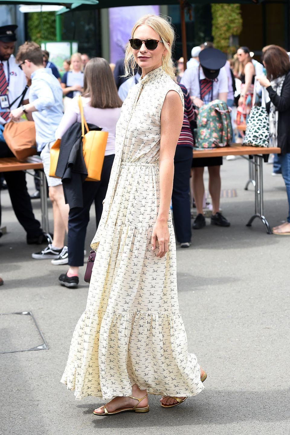 <p>The model and actress wore a Polo Ralph Lauren tiered maxi dress with gold sandals for a sunny visit to Wimbledon.</p>