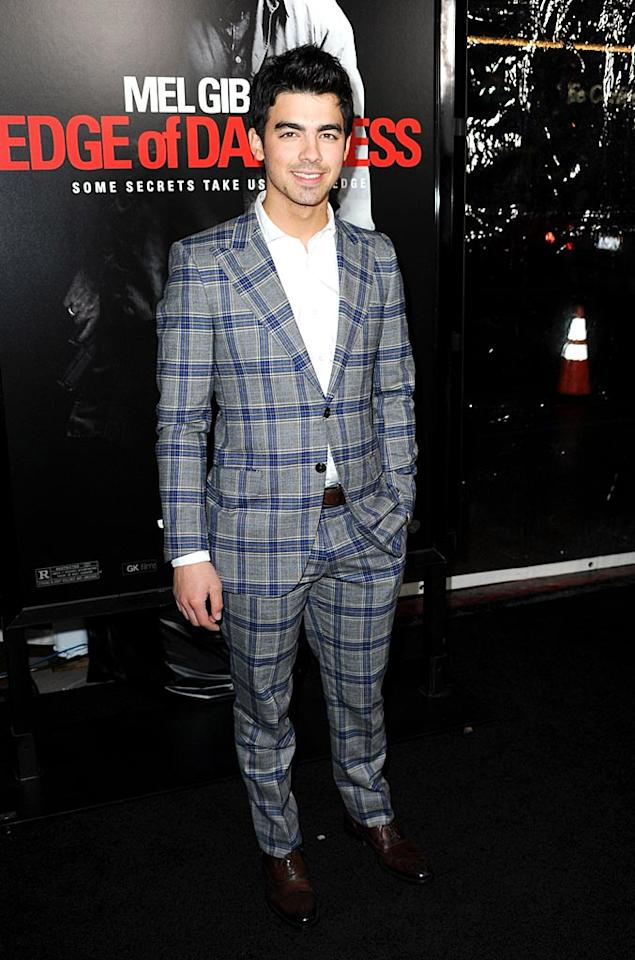 """Speaking of putrid patterns, what possessed Joe Jonas to sport this striped monstrosity to the premiere of Mel Gibson's new film, """"Edge of Darkness""""? Frazer Harrison/<a href=""""http://www.gettyimages.com/"""" target=""""new"""">GettyImages.com</a> - January 26, 2010"""