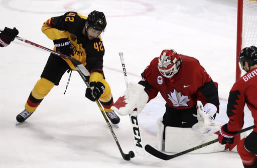 Yasin Ehliz (42), of Germany, shoots at goalie Kevin Poulin (31), of Canada, during the second period of the semifinal round of the men's hockey game at the 2018 Winter Olympics in Gangneung, South Korea, Friday, Feb. 23, 2018. (AP Photo/Frank Franklin II)