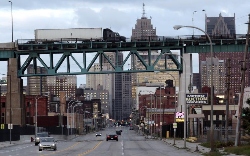 Commercial trucks travel over the land portion of the Ambassador Bridge to Windsor, Ontario over Jefferson avenue in Detroit, Michigan