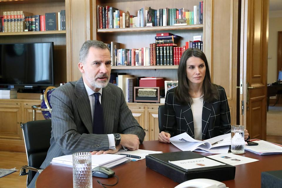 MADRID, SPAIN - APRIL 20: In this handout photo provided by Casa de S.M. el Rey Spanish Royal Household, King Felipe VI of Spain and Queen Letizia of Spain take part in a video conference with different sport entities at Zarzuela Palace on April 20, 2020 in Madrid, Spain. (Photo by Casa de S.M. el Rey Spanish Royal Household via Getty Images)