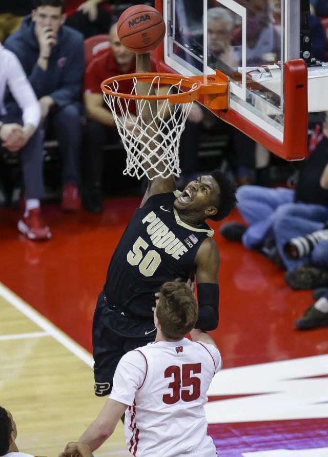 Purdue's Trevion Williams (50) dunks over Wisconsin's Nate Reuvers (35) during the first half of an NCAA college basketball game Friday, Jan. 11, 2019, in Madison, Wis. (AP Photo/Andy Manis)