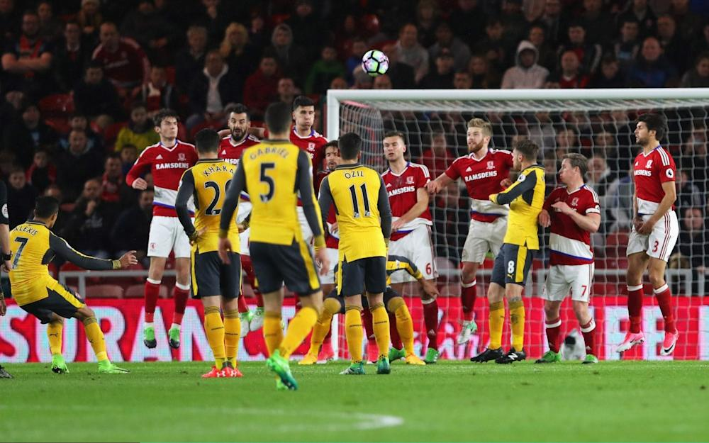 Alexis Sanchez scores with a freekick at Middlesbrough - Credit: Getty