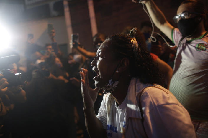 A family member screams during a protest against the killing of Kathlen Romeu, a young pregnant woman killed by a stray bullet, in Rio de Janeiro, Brazil, Wednesday, June 9, 2021. Stray bullets have struck at least six pregnant women in Rio since 2017, but Romeu was the first to die, according to Crossfire, a non-governmental data project that tracks armed violence. (AP Photo/Bruna Prado)