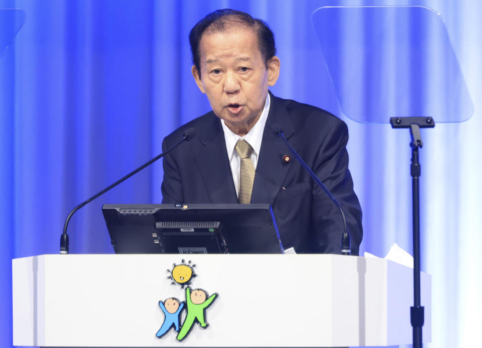 Japanese ruling Liberal Democratic Party (LDP) secretary general Toshihiro Nikai delivers a speech at the annual party convention amid outbreak of the new coronavirus in Tokyo Sunday, March 21, 2021. Japanese Prime Minister and LDP leader Yoshihide Suga pledged Sunday to do his utmost to prevent a resurgence of the coronavirus ahead of the Olympic torch relay and his upcoming visit to Washington. (Yoshikazu Tsuno/Pool Photo via AP)