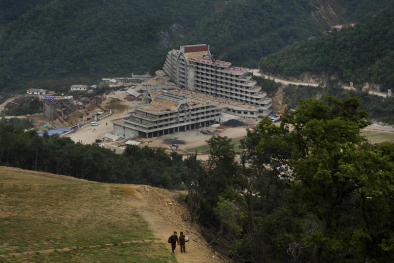 """In this Friday Sept. 20, 2013 photo, an unfinished hotel complex stands at the bottom of a mountain slope at the ski resort construction project at North Korea's Masik Pass. This is the Masik Pass ski resort, North Korea's latest megaproject, the product of 10 months of furious labor intended to show the world that this country, so often derided for its poverty and isolation, is as civilized and culturally advanced as any other. North Korean authorities have been encouraging a broader interest in sports in the country, calling it """"the hot wind of sports blowing through Korea."""" (AP Photo/David Guttenfelder)"""