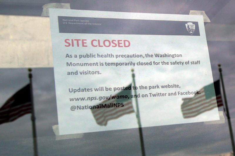 A closure note due to coronavirus disease (COVID-19) is seen at the entrance to the Washington Monument in Washington, U.S., March 14, 2020. REUTERS/Yuri Gripas
