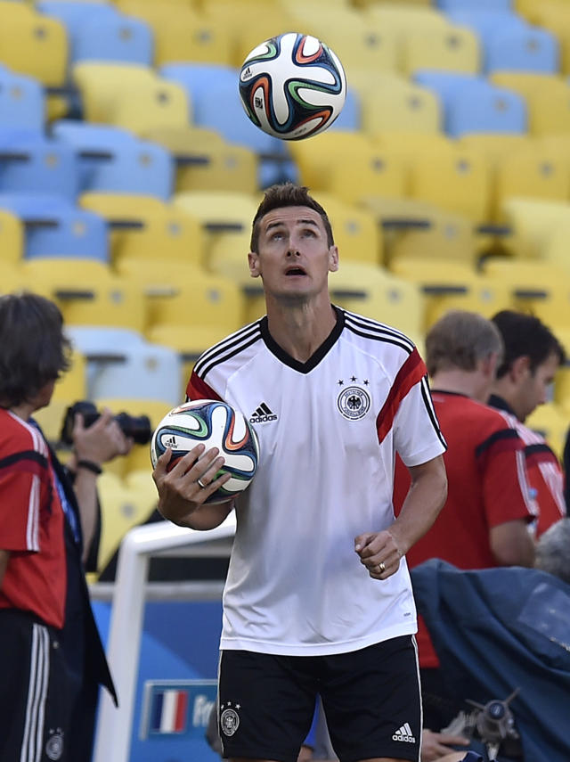 Germany's Miroslav Klose exercises with the ball during an official training session one day before the World Cup quarterfinal soccer match between Germany and France at the Maracana Stadium in Rio de Janeiro, Brazil, Thursday, July 3, 2014. (AP Photo/Martin Meissner)