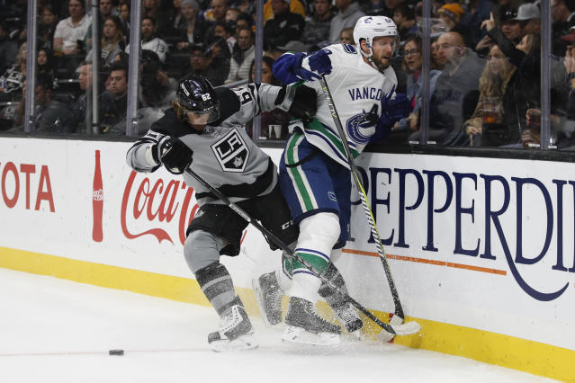 Vancouver Canucks' Alexander Edler, right, of Sweden, is shoved by Los Angeles Kings' Carl Hagelin, also of Sweden, during the second period of an NHL hockey game Saturday, Nov. 24, 2018, in Los Angeles. (AP Photo/Jae C. Hong)