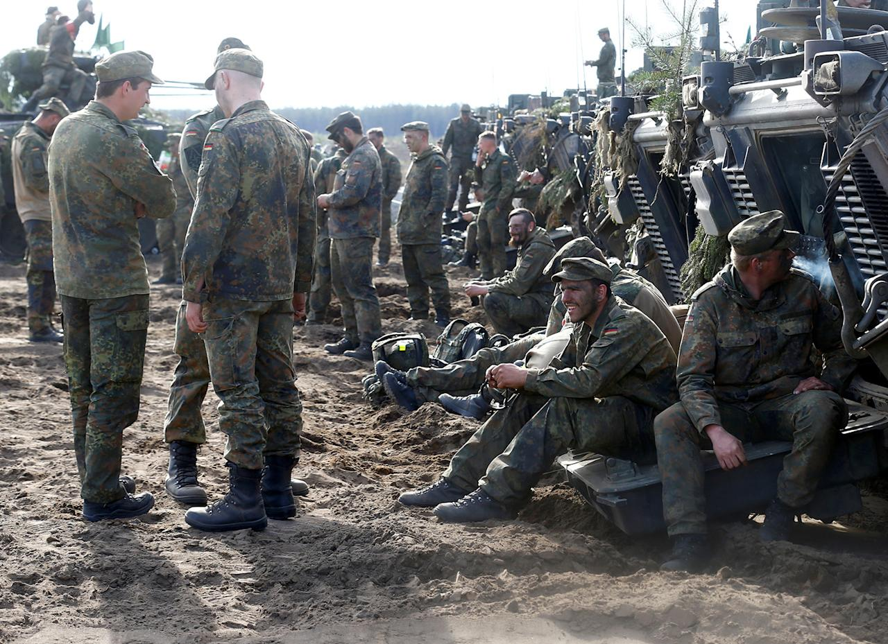 <p>German army soldiers rest after NATO enchanced Forward Presence Battle Group Lithuania exercise in Pabrade military training field, Lithuania, May 17, 2017. (Photo: Ints Kalnins/Reuters) </p>