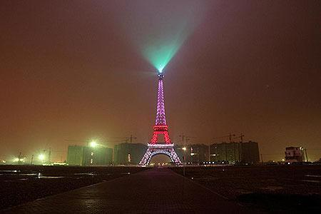 CHINA: A replica of the Eiffel Tower lights up on the outskirts of Hangzhou, Zhejiang province December 22, 2007.