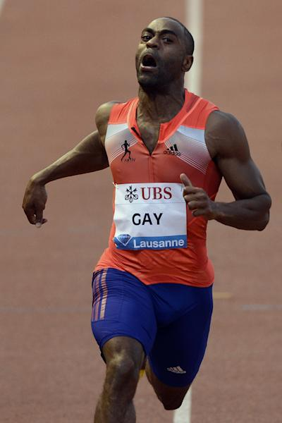 Tyson Gay, from the US, wins the men's 100m race, at the Athletissima IAAF Diamond League athletics meeting in the Stade Olympique de la Pontaise in Lausanne, Switzerland, on Thursday, July 4, 2013. (AP Photo/Keystone, Laurent Gillieron)