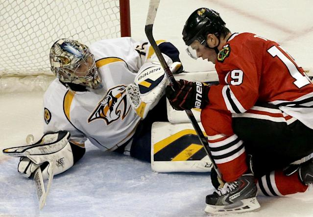 Chicago Blackhawks' Jonathan Toews (19), right, reacts after missing a shot as Nashville Predators goalie Pekka Rinne (35) looks on during the third period of an NHL hockey game in Chicago, Friday, March 14, 2014. The Predators won 3-2. (AP Photo/Nam Y. Huh)