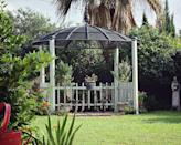 """<p>Believe it or not, this pretty gazebo was constructed from an old mesh satellite dish and low-cost bamboo strips using nothing but a drill and one hand tool. A salvaged tin finial serves as the gazebo's crowning glory. </p><p><strong>Get the look at <a href=""""https://spottingrainbows.wordpress.com/2014/07/15/satellite-upcycle/comment-page-1/"""" rel=""""nofollow noopener"""" target=""""_blank"""" data-ylk=""""slk:Spotting Rainbows"""" class=""""link rapid-noclick-resp"""">Spotting Rainbows</a>. </strong></p><p><a class=""""link rapid-noclick-resp"""" href=""""https://www.amazon.com/Favordrory-Inches-Sticks-Natural-Bamboo/dp/B07R4DZLVW/?tag=syn-yahoo-20&ascsubtag=%5Bartid%7C10050.g.30932979%5Bsrc%7Cyahoo-us"""" rel=""""nofollow noopener"""" target=""""_blank"""" data-ylk=""""slk:SHOP BAMBOO STRIPS"""">SHOP BAMBOO STRIPS</a></p>"""