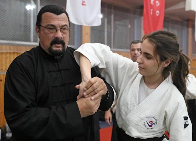 American actor and martial artist Steven Seagal (L) gives an aikido masterclass during the 2nd International Budo Festival at the Fili sports complex. (Vladimir Gerdo\TASS via Getty Images)