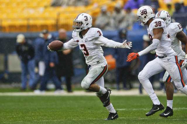 "Virginia safety <a class=""link rapid-noclick-resp"" href=""/ncaaf/players/243339/"" data-ylk=""slk:Quin Blanding"">Quin Blanding</a> (3) clebrates after making an interception against Pittsburgh during the second half of an NCAA college football game, Saturday, Oct. 28, 2017, in Pittsburgh. Pittsburgh won 31-14.(AP Photo/Keith Srakocic)"
