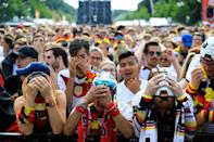 <p>Fans gather for a public viewing event to watch the 2018 FIFA World Cup Russia Group F match between Korea Republic and Germany, at the historical Brandenburg Gate in Berlin, Germany on June 27, 2018. (Photo by Abdulhamid Hosbas/Anadolu Agency/Getty Images) </p>