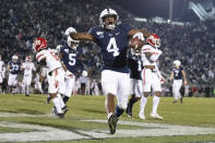 FILE - In this Nov. 30, 2019, file photo, Penn State running back Journey Brown (4) celebrates his third quarter touchdown run against Rutgers during an NCAA college football game in State College, Pa. Big Ten is going to give fall football a shot after all. Less than five weeks after pushing football and other fall sports to spring in the name of player safety during the pandemic, the conference changed course Wednesday, Sept. 16, 2020, and said it plans to begin its season the weekend of Oct. 23-24. (AP Photo/Barry Reeger, File)