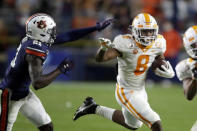 Tennessee running back Ty Chandler (8) tries to get past Auburn defensive back Smoke Monday (21) as he carries the ball during the first half of an NCAA college football game Saturday, Nov. 21, 2020, in Auburn, Ala. (AP Photo/Butch Dill)