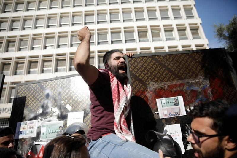 A protester shouts slogans at a demonstration outside of Lebanon Central Bank during ongoing anti-government protests in Beirut