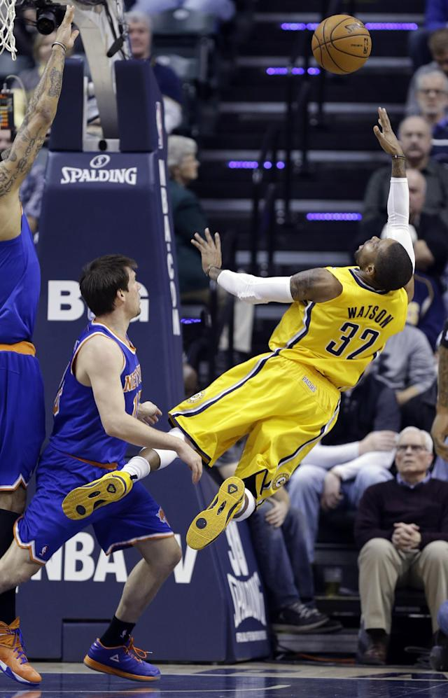 Indiana Pacers guard C.J. Watson, right, attempts a shot in front of New York Knicks guard Beno Udrih during the first half of an NBA basketball game in Indianapolis, Thursday, Jan. 16, 2014. (AP Photo/Michael Conroy)