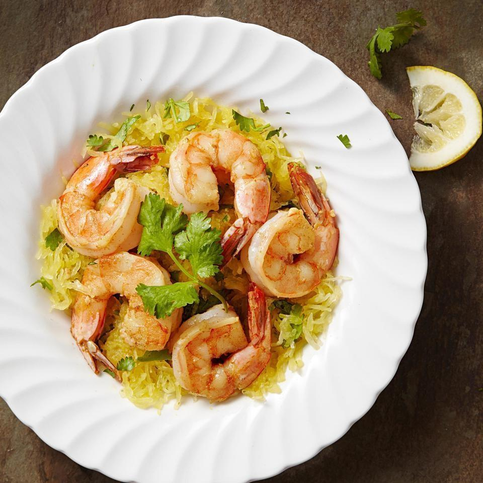 <p>Garlicky shrimp are served on top of buttery, cilantro-flecked spaghetti squash in this quick, healthy dinner recipe inspired by shrimp scampi. Pair with a side of sautéed greens, such as kale, collards or spinach.</p>