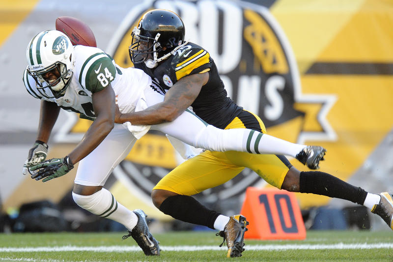 Pittsburgh Steelers free safety Ryan Clark (25) holds on to New York Jets wide receiver Stephen Hill (84) after breaking up a pass in the second quarter of an NFL football game, Sunday, Sept. 16, 2012, in Pittsburgh. (AP Photo/Don Wright)