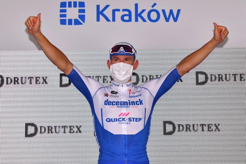 KRAKOW POLAND AUGUST 09 Podium Davide Ballerini of Italy and Team Deceuninck QuickStep Celebration during the 77th Tour of Poland 2020 Stage 5 a 188km stage from Zakopane to Krakow TourdePologne tdp20 on August 09 2020 in Krakow Poland Photo by Luc ClaessenGetty Images