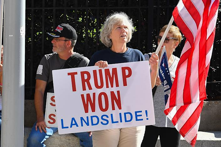ATLANTA, GA  NOVEMBER 28:  A supporter of President Trump holds a sign at a Stop The Steal rally in front of the Georgia State Capitol Building on November 28th, 2020 in Atlanta, GA. (Photo by Rich von Biberstein/Icon Sportswire)