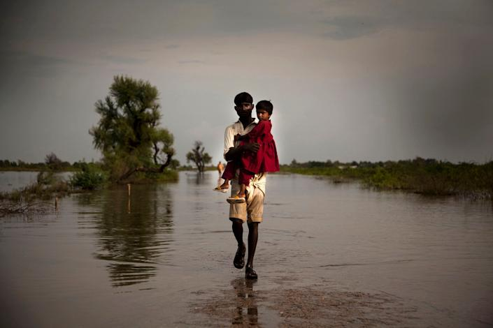 On Sept. 11, 2011, a man carries his daughter across an expanse of flood water in the city of Digri, in Sindh Province. By Sept. 26 in Pakistan, over 5.4 million people, including 2.7 million children, had been affected by monsoon rains and flooding, and this number was expected to rise. In Sindh Province, 824,000 people have been displaced and at least 248 killed. Many government schools have been turned into temporary shelters, and countless water sources have been contaminated. More than 1.8 million people are living in makeshift camps without proper sanitation or access to safe drinking water. Over 70 per cent of standing crops and nearly 14,000 livestock have been destroyed in affected areas, where 80 per cent of the population relies on agriculture for food and income. Affected communities are also threatened by measles, acute watery diarrhoea, hepatitis and other communicable diseases. The crisis comes one year after the country�s 2010 monsoon-related flooding disaster, which covered up to one fifth of the country in flood water and affected more than 18 million people, half of them children. Many families are still recovering from the earlier emergency, which aggravated levels of chronic malnutrition and adversely affected primary school attendance, sanitation access and other child protection issues. In response to this latest crisis, UNICEF is working with Government authorities and United Nations agencies and partners to provide relief. Thus far, UNICEF-supported programmes have immunized over 153,000 children and 14,000 women; provided nutritional screenings and treatments benefiting over 2,000 children; provided daily safe drinking water to 106,700 people; and constructed 400 latrines benefiting 35,000 people. Still, additional nutrition support and safe water and sanitation services are urgently needed. A joint United Nations Rapid Response Plan seeks US$356.7 million to address the needs of affected populations over the next six months.
