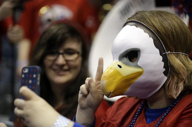 A fan takes a picture of herself during the first half of a second round NCAA college basketball tournament game between the Wisconsin and the American Thursday, March 20, 2014, in Milwaukee. (AP Photo/Jeffrey Phelps)