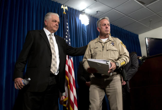 Clark County Commissioner Steve Sisolak, left, and Las Vegas Metropolitan Police Department Sheriff Joe Lombardo leave a media briefing at police headquarters in Las Vegas on Wednesday. (Photo: Steve Marcus/Las Vegas Sun via AP)